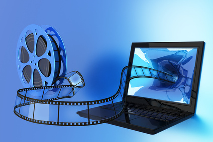 reel of film with film flowing into a computer