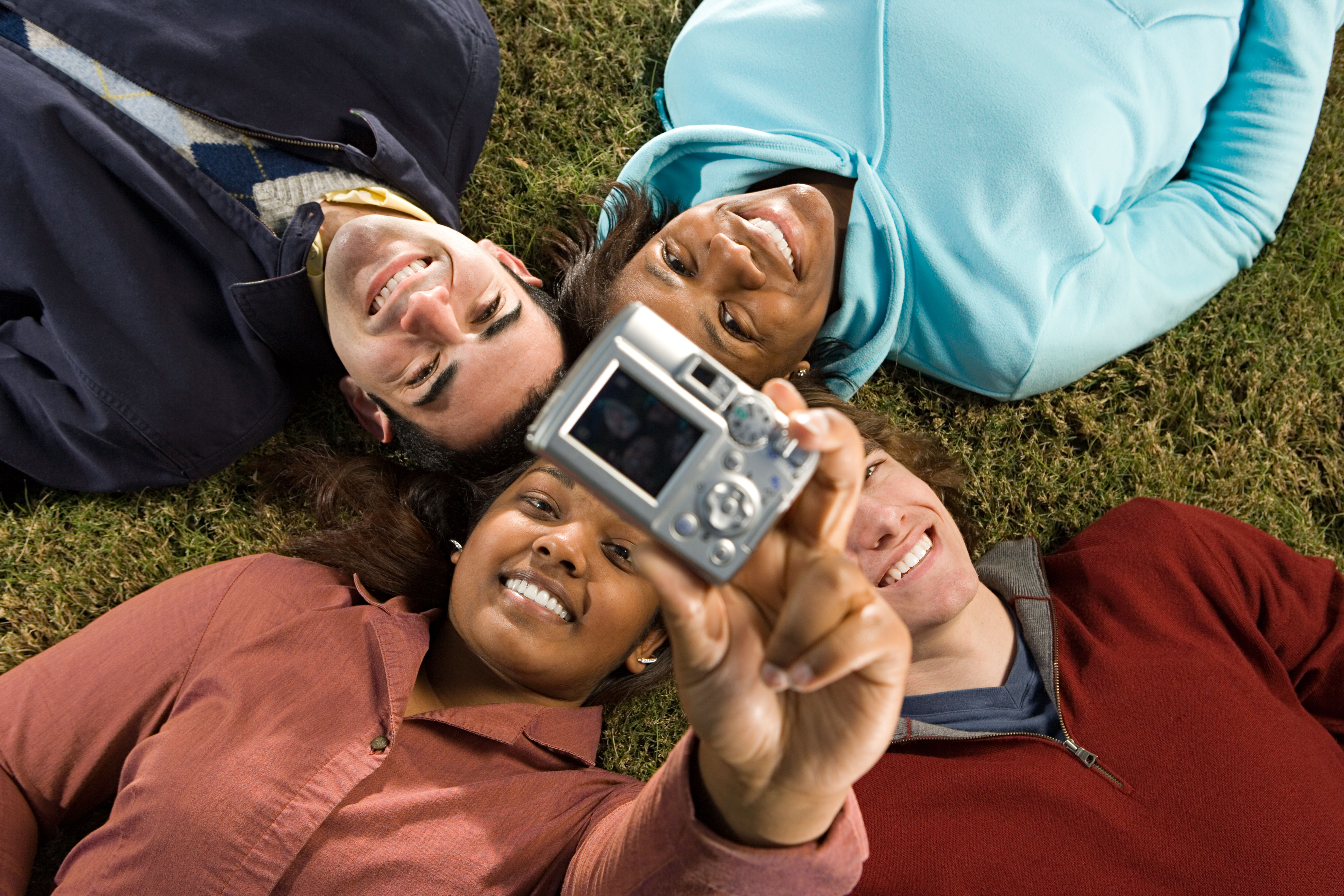 Four students taking a picture