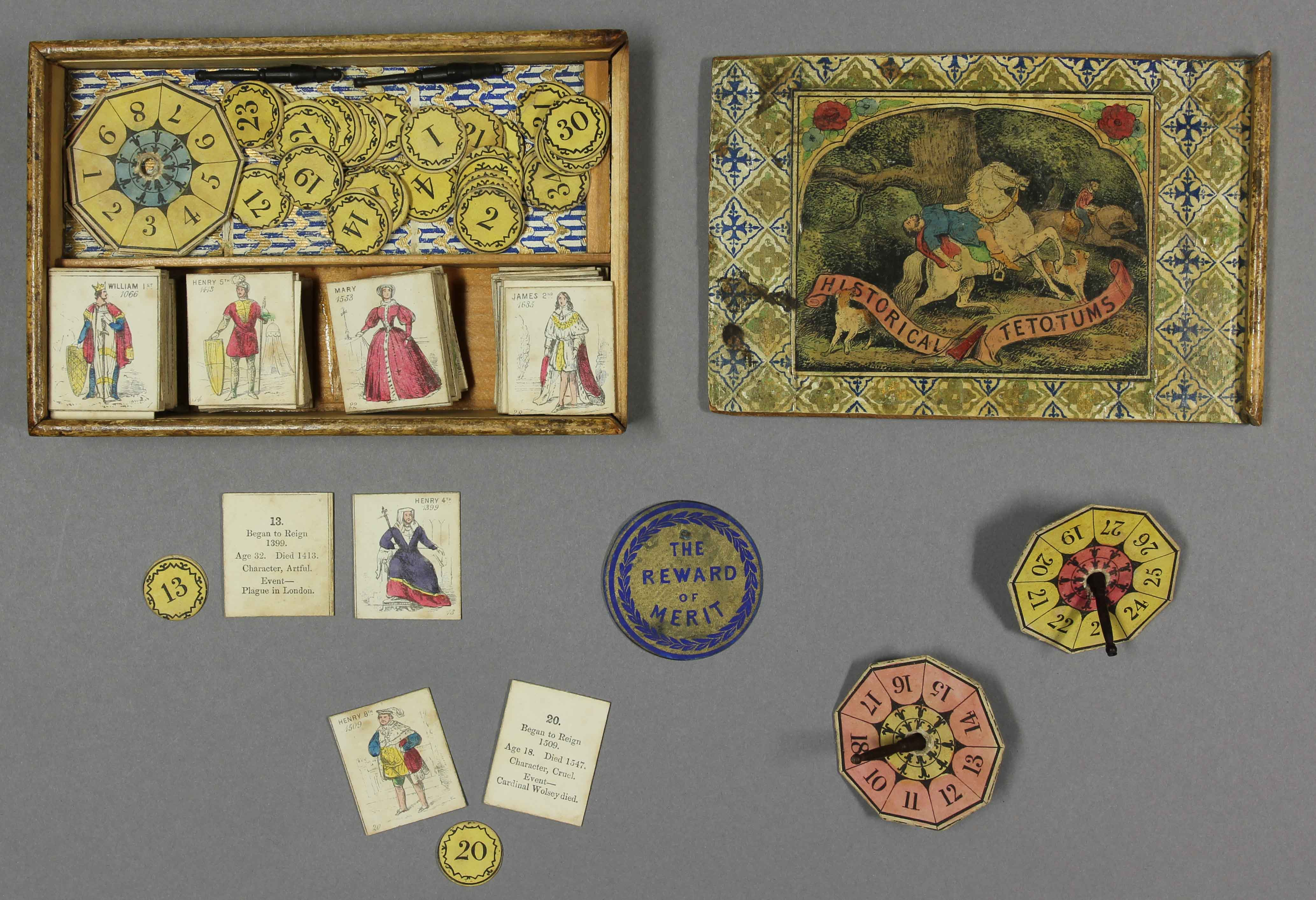 The game Historical Tetotums showing box with cards, pieces and tetotums
