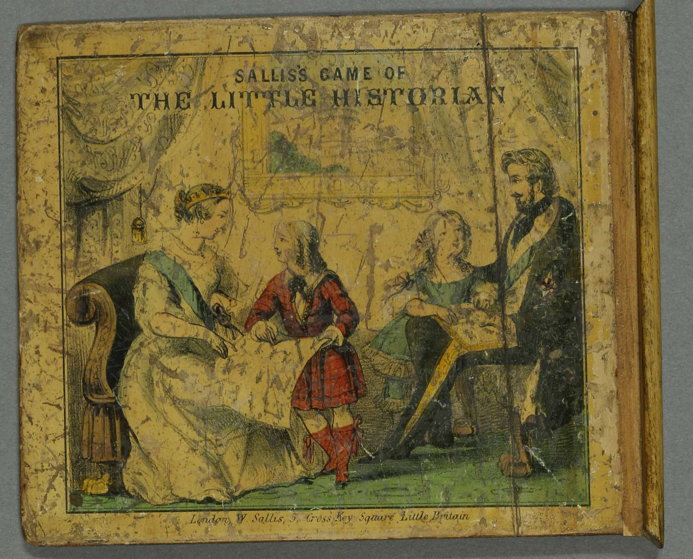 Box lid of The Little Historian, showing Queen Victoria and Prince Albert playing the game with their children