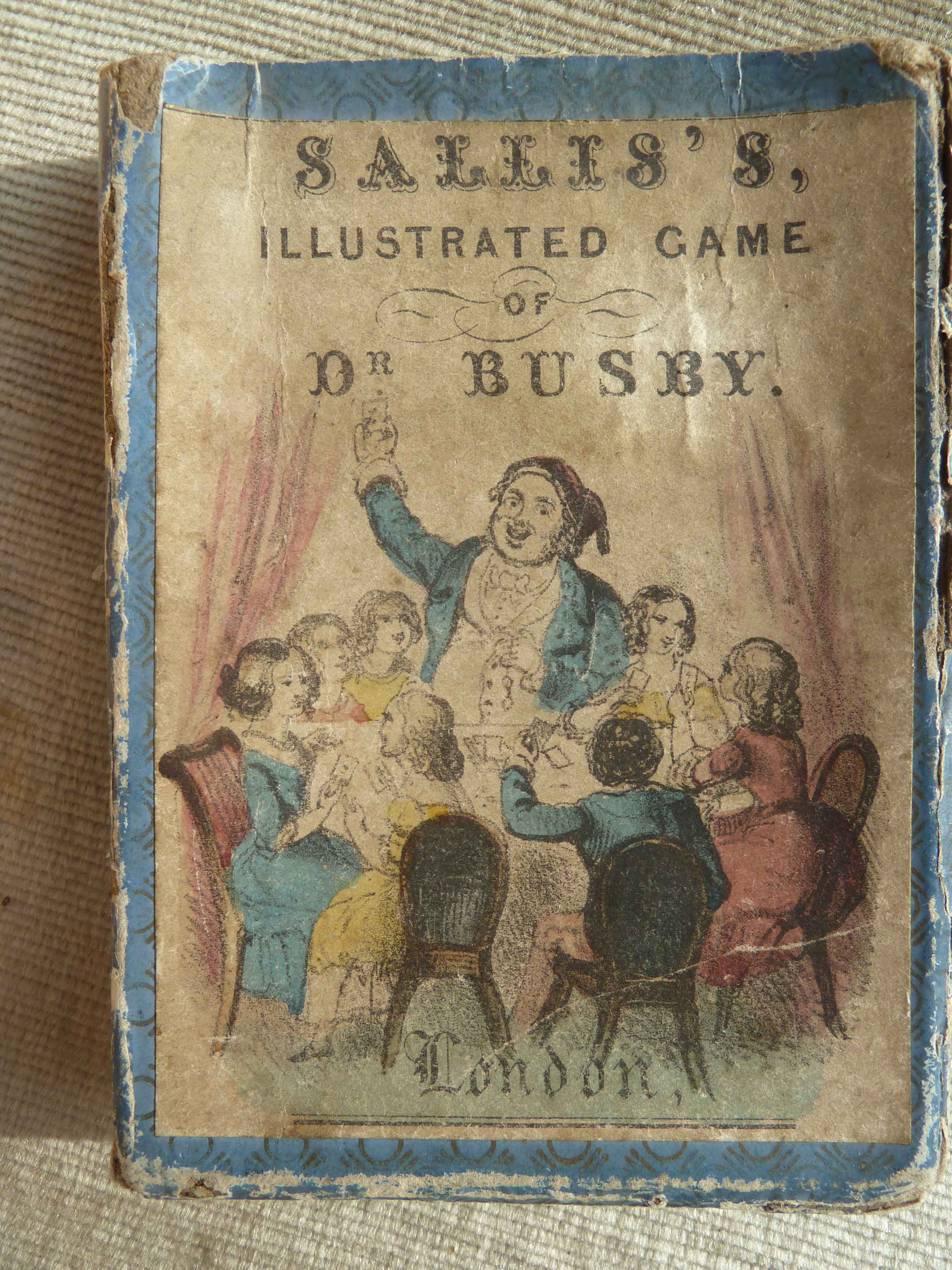 Slip case of Sallis's Illustrated Game of Dr. Busby, showing children playing game, around 1850