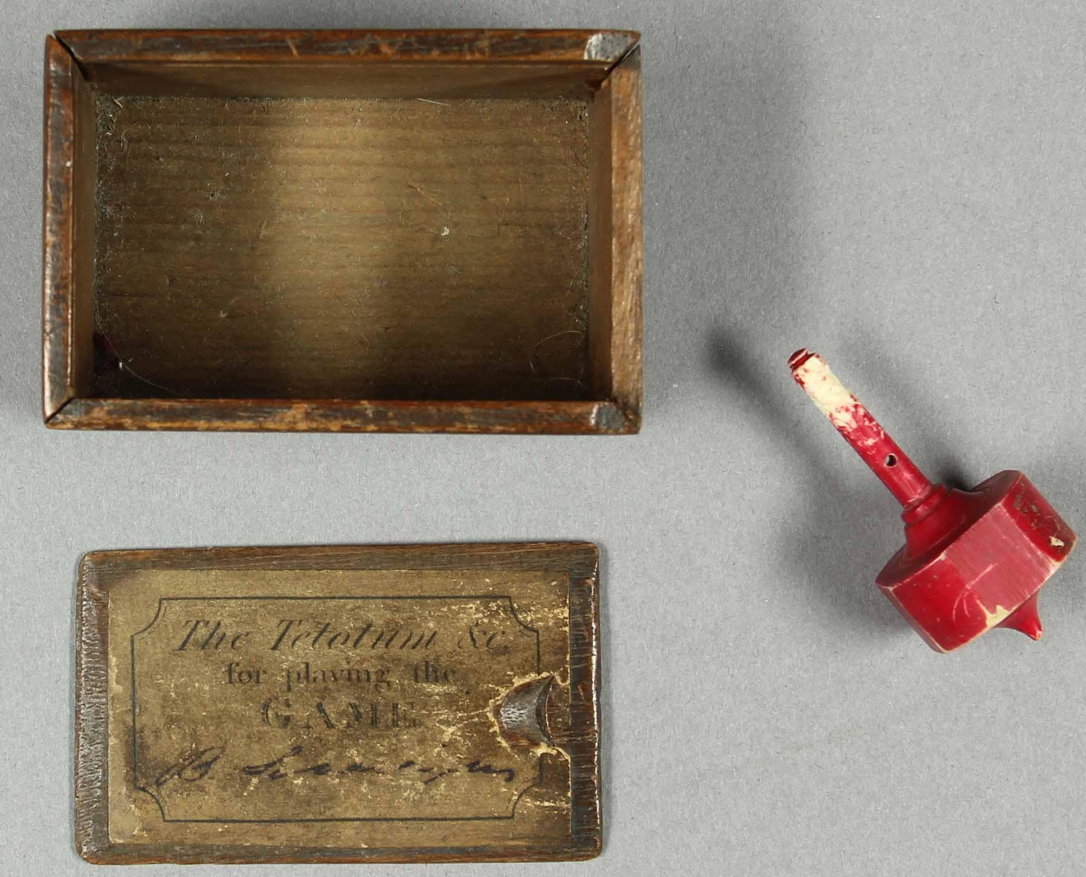 Tetotum in box, with 'British sovereigns written in manuscript on label