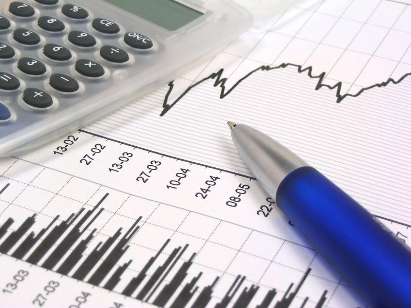 accountant's tools - calculator, pen, graphs