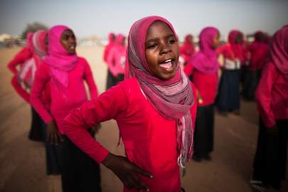 "UNAMID Hosts Cultural and Sports Event. The African Union-United Nations Hybrid Operation in Darfur (UNAMID) hosted a cultural and sports event in El Sereif, North Darfur, as part of its ""We Need Peace Now"" campaign. School girls from El Sereif perform traditional songs and dances during the cultural and sports event organized by UNAMID. 20 May 2014. El Sereif, Sudan"
