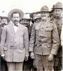 eneral Pershing stands next to Pancho Villa, apparently on friendly terms, before the Columbus Raid.