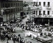 The Ku Klux Klan marches in a parade in downtown El Paso around 1920.