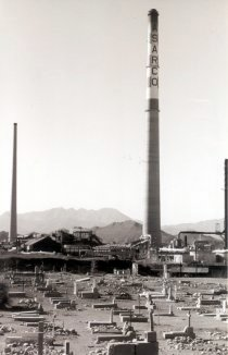 Asarco stacks tower over Smeltertown Cemetery.