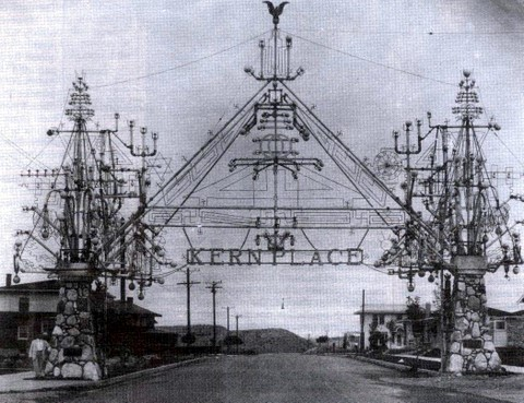Peter Kern stands by his ornate Kern Place gate