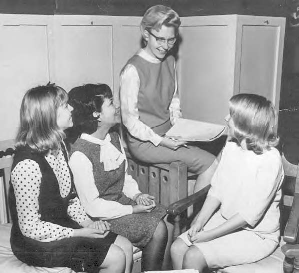 Myrna Deckert with group of girls