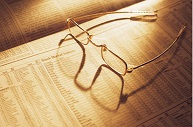 eyeglasses sitting on a newspaper