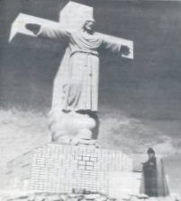 Cristo Rey statue with Father Costa