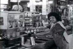Libby Dominguez prepares milk shake at San Pedro Pharmacy.
