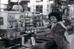 Libby Dominguez prepares milk shake at San Pedro Pharmacy.