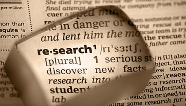 "A magnified close up of the definition of ""research."""