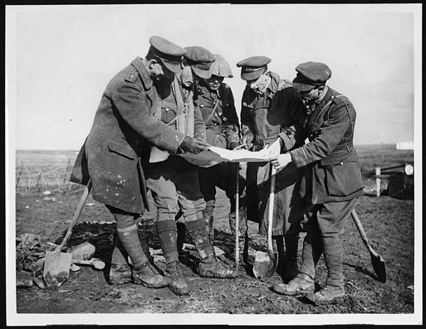 Picture of officers studying map
