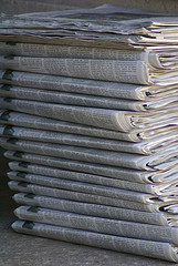 Newspaper pile, by Valerie Everett, Flickr