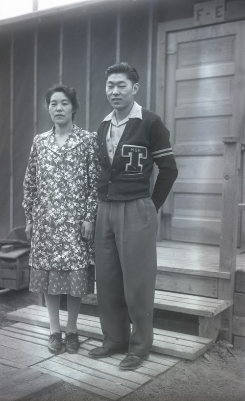 Kiyo and Makio Hide Standing in front of barracks at the Heart Mountain Internment Site
