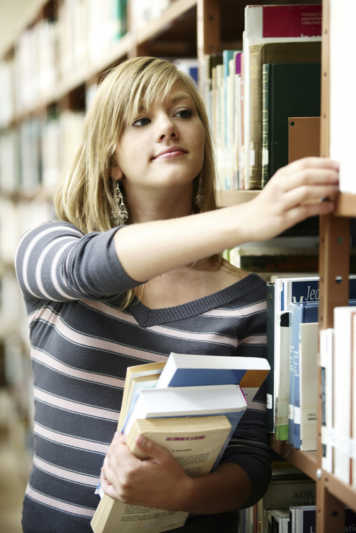 female student shelving books