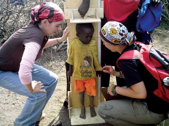 NAU student with Kenya child