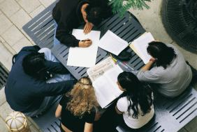 students reading at a table [Image source: UniSA Image Library]