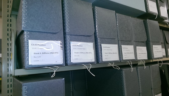 Archival boxes labelled Frank S. DiPietro collection line a shelf.