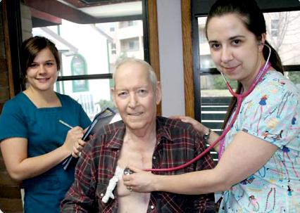 Image of Nurses helping elderly gentleman, from sxc.hu
