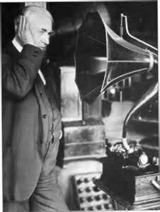Old Image of Man Listening to Antique Phonograph Record Player