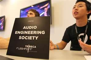 Image of Two College Students with Sign For Audio Engineering Society