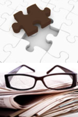 Image of newspapers, glasses and jigsaw puzzle