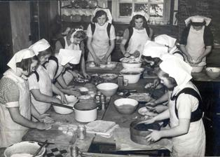 Photo of girls working in a home economics class, photo from the Brenda Francis Archive