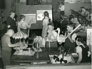 Photograph of children working on art projects, 1950s