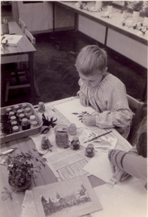 Photo of a young boy in an art class