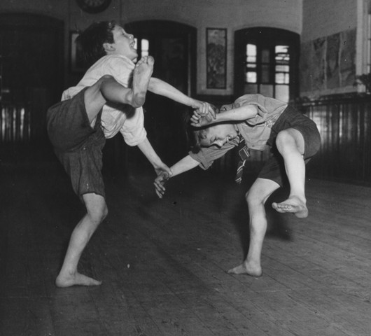 Two boys playing in a classroom, circa 1950