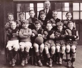Photograph of Arthur Sporne with a boys' football team