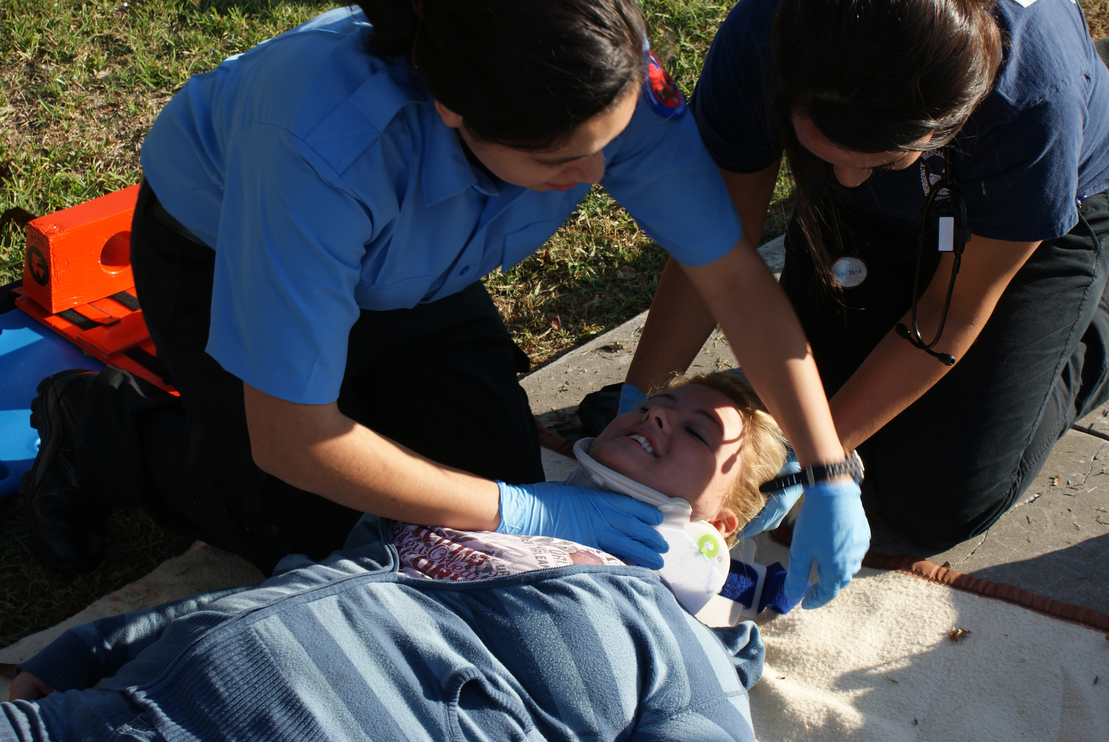 Image of Medical Emergency Workers Applying a Neck Brace