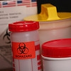 Specimen containers with biohazard labels