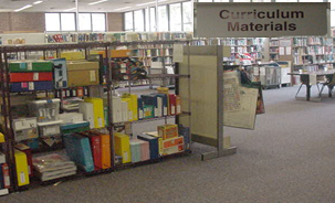 Books and kits shown in Curriculum Materials room