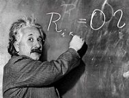 photo of Albert Einstein writing on a chalkboard