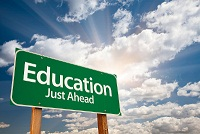 "picture shows sign that says, ""Educaton, Just Ahead"""
