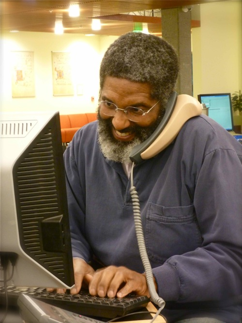 Photo of Librarian Ken Lyons on the phone
