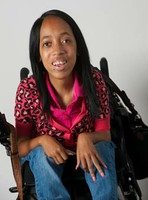 Young college student in a wheelchair smiling for the camera