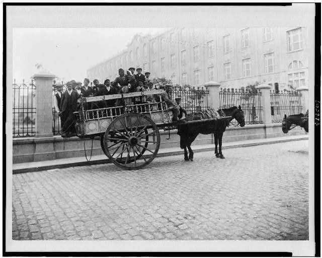 [Immigrants being transported on horse-drawn wagon, Buenos Aires, Argentina]