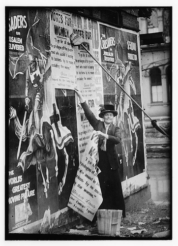 Suffragettes posting bills