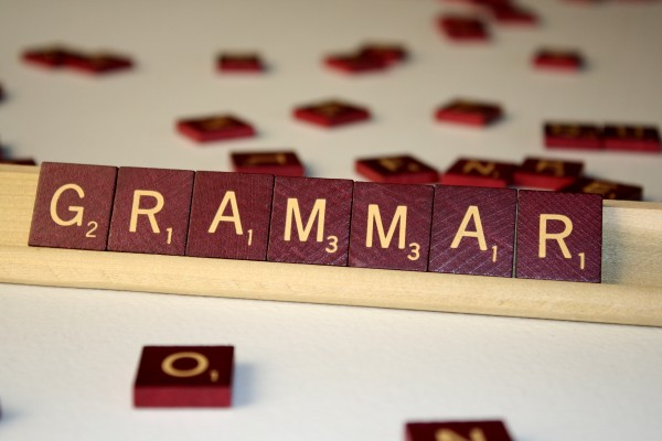 grammar spelled in scrabbled tiles