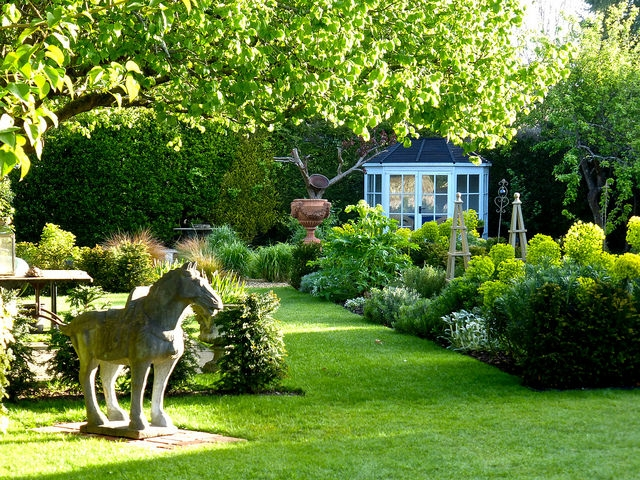 Photo illustrating garden ornaments providing direction, movement and space; photo Courtesy of Flickr cc/ Herry Lawford