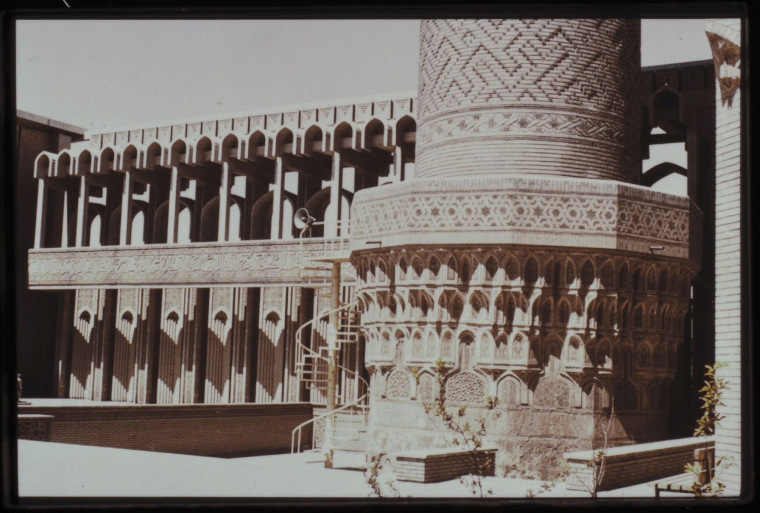 Courtyard, detail of base of minaret; with riwaq, 1970s
