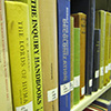 Thumbnail cropped from photo of books on shelves in the General Collection