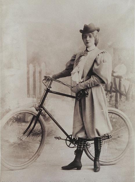 Woman in bloomers, standing with a bicycle, 1894. Dorothy Dignam Papers.