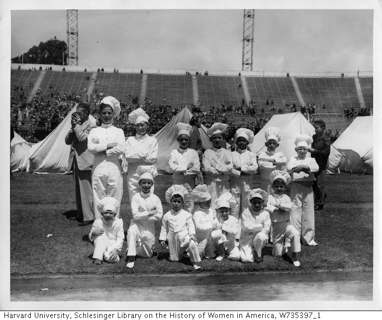 Group portrait of boys dressed as chefs, ca. 1950.
