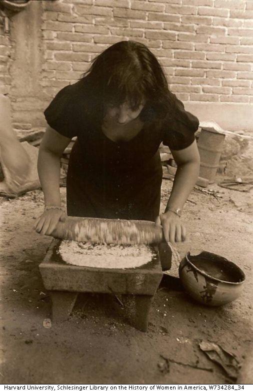 Zarella Martinez grinding corn.